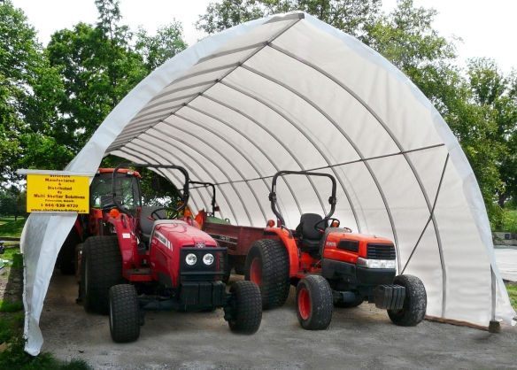 tractors stored in a structure