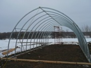It is important to remember that when the structure is being pulled from a single point, it will want to collapse. Therefore it is necessary to have something solid across at the front. This will be just high enough to clear crops. The rest of the structure will want to spread so it also must be secured but with cables.